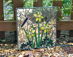 Welsh daffodils and shamrocks (gardenreflections) Tags: garden mirror dragonfly stainedglass ladybird shamrock welshdaffodils