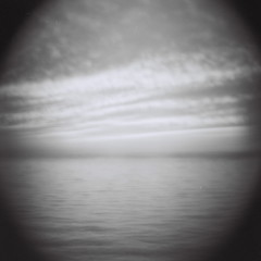 Lake Michigan, by request (kevin dooley) Tags: camera sunset blackandwhite bw cloud white lake black 120 film water weather analog lens lomo lomography cloudy dusk michigan gray monotone lakemichigan telephoto diana medium format analogue ilford tempe request newbuffalo byrequest cloudage tempecamera dianatelephotolens dianatelephoto