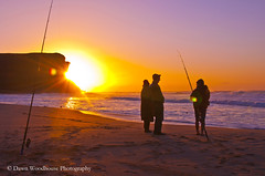 Gathered on the beach (Dawn Woodhouse) Tags: sun beach sunrise golden fishing glow peace australia garie wow1