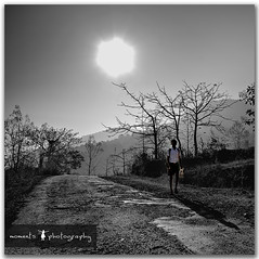 walking towards progress... (PNike (Prashanth Naik..back after ages)) Tags: road street school trees boy sky bw india monochrome rur