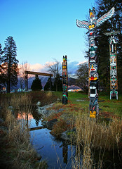 Totem Poles at Vancouver Stanley Park (TOTORORO.RORO) Tags: travel canada reflection art vancouver lens mirror bc britishcolumbia sony tourist firstnations totempole translucent stanleypark alpha f28 hdr slt ssm nationalgeographic artistry greatervancouver a55 1650mm sal1650