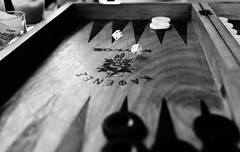 Playing tavli while drinking a coffee (AkisFis) Tags: bw white dice motion black closeup nikon tavli d300s