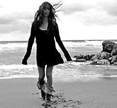 trespass beach (nikkidelmont) Tags: ocean portrait bw beach girl self nikon rocks wind florida grain s infrared nikkidelmont