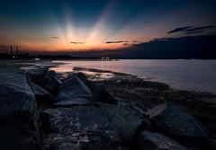 Old Bridge Sunset (Dalliance with Light) Tags: sunset sky water landscape us newjersey rocks unitedstates rays waterfrontpark raritanbay oldbridgetownship cheesequakecreek