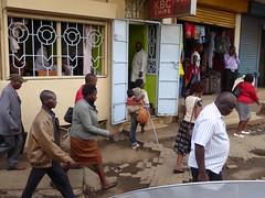 Amputee with a baby (prondis_in_kenya) Tags: baby traffic kenya pavement walk nairobi leg pedestrian crutch amputee longrains