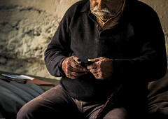 New tricks (Ommation (Vasilis Benakis)) Tags: old man colors canon greek hands village skin magic grandfather oldman dirty greece nails human crete granny oldnew chania