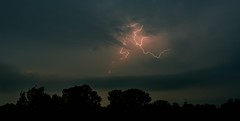 Out of the Clouds Lightning (thefisch1) Tags: sky cloud storm tree weather silhouette photo interesting nikon calendar hills kansas lightning nikkor flint thunder oogle convoluted
