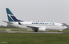 WestJet 737-700 C-GYWJ (birrlad) Tags: ireland dublin toronto canada airplane airport taxi aircraft aviation airplanes stjohns international airline boeing airways airlines westjet departure takeoff runway dub airliner 737 departing taxiway b737 737700 7377ct ws17 cgywj
