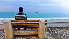 The Meditation (khalid almasoud) Tags: leica november sea man beach nature weather idea chair flickr all quiet photographer place 5 horizon  rights estrellas meditation kuwait ponder seen khalid reserved dlux   almasoud  dlux5 thebestofday gnneniyisi leicadlux5