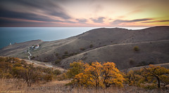 The lost lighthouse (wind of renovatio) Tags: road autumn trees sunset sky lighthouse seascape water grass landscape ukraine hills crimea blacksea          canonef2470f28l meganom      5dmkii canon5dmarkii  windofrenovatio
