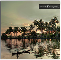 an everyday scene from the backwaters.. (explored) (PNike (Prashanth Naik..back after ages)) Tags: trees sunset sky orange india lake reflection water colors evening nikon asia kerala rowing ripples backwaters bo