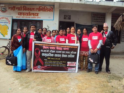 Volunteers with banner