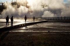 Steamy stroll (Rozanne Hakala) Tags: park morning people usa sun tourism water sunrise landscape outdoors us scenic silhouettes tourist steam unescoworldheritagesite explore crater caldera yellowstonenationalpark boardwalk yellowstone wyoming geyser nationalparkservice bacteria geothermal thermal ynp steaming caldron wy microorganisms runoff hellshalfacre snakeriverplain midwaygeyserbasin thermophiles excelsiorgeyser bacterialmats specialpicture greateryellowstoneecosystem firstnationalpark yellowstonecaldera yellowstoneplateau rozannehakala