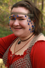 Kelsey in Red (wyojones) Tags: red woman usa cute girl beautiful beauty smile look festival lady pretty texas braces lips blouse trf faire brunette browneyes fest renaissance renfest choker chainmail headband wench texasrenaissancefestival toddmission silversmile wyojones sliversmile