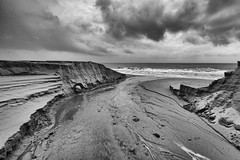 dark beach days (-hedgey-) Tags: ocean bw seascape beach clouds dark sand stormy inlet channel mygearandme mygearandmepremium mygearandmebronze mygearandmesilver mygearandmegold mygearandmeplatinum mygearandmediamond