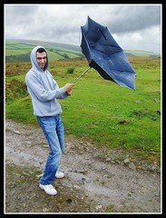 Umbrella (Jon 89) Tags: park blue autumn trees boy summer england white storm man west green broken public grass rain weather forest laughing umbrella pose out walking person foot grey countryside george hoodie holding woods scenery funny rocks day view cloudy britain path stones walk joke south united great gray navy bad scenic kingdom stormy somerset visit trainers reservoir september hills jeans trail faded national rainy damage bleak moors inside damaged amused footpath hold distant exmoor 2011 nutscale