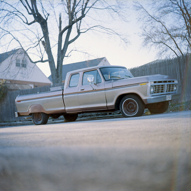 rainbow ford truck flat tires tire tree fence dof depth field film asa analog manual focus iso vintage camera samlehman kodak portra 160vc yashica a medium format 120 6x6 maryland md square parkville baltimore county f100 f150 supercab 1973 1974 1975 fender skirts photography photograph photo photos