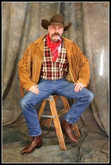 Classy Cowboy (Cowboy Tommy) Tags: portrait hairy man hot face hat leather hair beard cowboy legs boots body cigarette smoke coat blueeyes handsome wranglers crotch tommy smoking moustache western stache tight plaid cowboyhat stud rugged cowboyboots hankie hanky madeintheusa schotts fringejacket