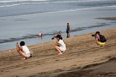 Photographers (Matthew Kenwrick) Tags: camera morning travel november bali holiday beach canon indonesia photography early funny asia evolution humour tropical evolutionary kutabeach 70200mmf4 2011 eos40d