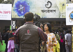 TV Reporter (Pagan Eyes) Tags: camera woman man clown reporter dhaka clowns bd bangladesh cameraman bookfair tvreporter buffoon buffoons ekusheybookfair