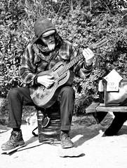 Street Performer (Stefano Faccenda) Tags: barcelona people blackandwhite bw spain artist colours faces guitar cd espana gita barcellona spagna chitarra facce aluminiumguitar