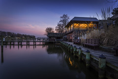 Seafood Shack (Joe Rebello) Tags: longexposure sunset landscape restaurant pier twilight md waterfront outdoor dusk boardwalk dining ripples bluehour annapolis millcreek pinkclouds cantlersriversideinn seafoodshack