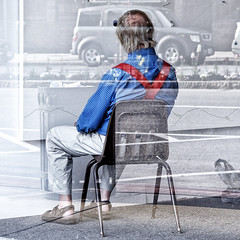 Seated Man (Geoffrey Coelho Photography) Tags: street city blue red urban abstract man art window shirt chair artist gallery sandals massachusetts working sidewalk reflected berkshires reverse suspenders reversed seated atwork northadams berkshirecounty