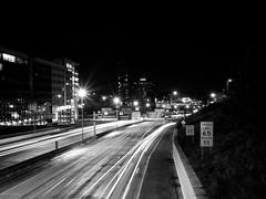 I-196 (Jack Amick) Tags: city light bw white black cars night speed dark lights highway michigan grand olympus rapids trail limit ep1 196