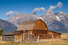 Moulton Barn - Grand Teton National Park (John Cothron) Tags: old summer sky usa cloud mountain building nature barn 35mm canon landscape morninglight outdoor sunny age wyoming grandtetonnationalpark mormonrow antelopeflats moultonbarn johncothron 5dmkii cothronphotography