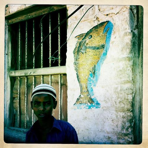 Kid in Berbera fish market  thru Iphone Hipstamatic - Somaliland