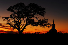 Golden sky at St. Olaf's Church - Cranfills Gap, Texas (eedgejr) Tags: old sunset church silhouette st rock oak texas live gap olafs cranfills