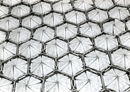 Tetra Pak - Tetra Classic Aseptic packages in steel baskets, 1960s.