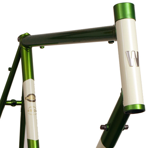 <p>Front view of Waterford with Italian-Cut lugs, Chevron panels painted Sunshine Yellow over Shamrock Green.  Also shown is the brazed-on headbadge in polished stainless steel and a head tube extension.  62545</p>