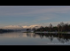 Snow-capped (w.mekwi photography [on the road]) Tags: trees snow mountains reflection landscape hills snowcapped trossachs balloch lochlomond lochlomondshores valeofleven nikkor35mmf18 nikond7000 wmekwiphotography mekwicom