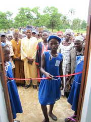 girl ribbon cutting