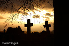Spooky Sunset (Yorkshire Pics) Tags: sunset cemetery graveyard weather silhouette sunrise cross leeds spooky gravestone churchyard sillhouette westyorkshire rothwell 2410