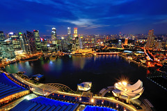 The Singapore Metropolis (Rebecca Ang) Tags: lighting city longexposure nightphotography blue light architecture night marina reflections dark lights twilight singapore cityscape dusk aerial financialdistrict aerialphoto metropolis bluehour afterdark mbs aerialshot skypark thebluehour marinabay delayedexposure duskphotography marinabaysands marinabayarea d7000 esplanadetheatresbythebay nikond7000 marinabayfinancialcentre artsciencemuseum marinabaysandsskypark marinabayfinancialcenter skyparkviewinggallery