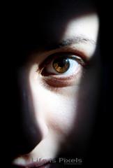 The Eye (LifeisPixels - Thanks for 5 MILLION views!) Tags: light shadow woman brown eye girl face mystery lady lens thailand european bangkok sony latina tamron f28 2875mm a850 lifepixels lifeispixels sonyalphathailand lifeispixelscom
