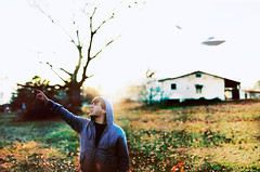 the first encounter. (Casey David) Tags: blue light boy sunset portrait sky house selfportrait tree green up yellow self project 50mm flying hoodie scary day dof looking bright bokeh vibrant space 14 alien ufo days lookingup fields hood 365 flyingsaucer outerspace dying pointing desolate closeencounters abduction spielberg saucer ufos closeencountersofthethirdkind unidentifiedflyingobject project365 365days abduct caseydavid caseydavidphotography