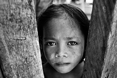 Eyes of Curiosity | Sea Gypsy at Mabul Island (wazari) Tags: ocean poverty life travel sea water kids children island photography boat asia photographer rustic adventure journey malaysia borneo gypsy malaysian sabah kapalai mabul asean traveler waterworld seagypsies hardship hardlife seagypsy malaysianphotographer lifeishard bajau dulang northborneo pulaumabul landbelowthewind bajaulaut wazari badjou lifebythesea boheydulang wazariwazir bohey malaysianorthborneo pulauboheydulang