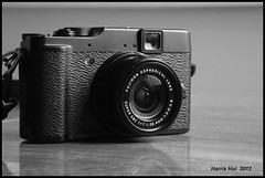 My New Toy Fuji X10 S1596e (Harris Hui (in search of light)) Tags: camera bw stilllife canada monochrome vancouver toy mono blackwhite fuji bc richmond fujifilm digitalbw windowlight newtoy compactcamera mynewtoy s1600 fujis1600 homephotography harrishui vancovuerdslrshooter fujix100 fujix10 retrostylecamera judgethebookbyitscover seetheappearanceofagirlatfirstglance fujixseriescamera fujixpro1cameraiscoming
