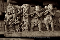 Halebeedu - Bhairava Dancing (Sarang Norway) Tags: travel sculpture india stone sepia canon temple photography 50mm ancient south photojournalism carving jewellery archetecture shiva karnataka dynasty halebid dravidian halebeedu kannada hoysala vaishnava vishnuvardhana 40d shaivite hoysaleshwara shantaleshwara