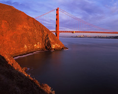 Gold on Gold (RZ68) Tags: city bridge light sunset sky sun film water clouds reflections golden evening bay kirby gate san francisco cityscape angle near cove marin wide cliffs velvia headlands provia wagner ggnra e100