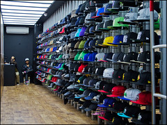 Hats, innit. (Sven Loach) Tags: uk england urban london window shop canon mall shopping cool workers sitting lads display britain working bored hats streetphotography guys row trainers shoreditch getty hiphop popup colourful hip rap innit baseballcaps eastlondon geezers assistants blokes beanies g12 berets boxpark