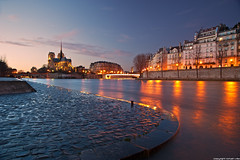Cathedrale Notre-Dame et Quai d'Orlans - Paris (romvi) Tags: longexposure sunset paris france church monument water architecture buildings river atardecer nikon eau europe tramonto religion perspective iglesia notredame chiesa villa reflets romain quai eglise cathedrale fleuve couchdesoleil pavs laseine dorlans immeubles batiments catholique quaidorlans cathedralenotredame longuepause d700 romainvilla felections romvi cobllestone