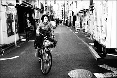 Shimo-Kita rider (Eric Flexyourhead) Tags: street city urban bw woman girl bicycle japan japanese tokyo blackwhite cyclist   rider streetscape setagaya shimokitazawa   setagayaku grainyfilm artfilter olympusep1 panasoniclumix20mmf17