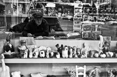 Through the glass #7 (Ayertosco) Tags: world street city light shadow blackandwhite bw italy white black eye art window glass monochrome look contrast 35mm blackwhite eyecontact italia fuji humanity photos candid streetphotography x human fujifilm varese shopwindows xseries x100 23mm xshooter fujifilmx100 emanueletoscano wwwblackbulbnet theoutsidewindowcom fujifilmitalia theutsidewindowcom