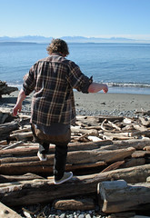 Michael climbs over the logs to get to the beach (Librarianguish) Tags: walk gorgeous bluff sunnyday 212 ebeyslanding unseasonablywarm