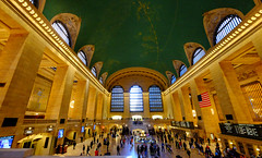 Grand Central Station in New York (` Toshio ') Tags: nyc newyorkcity windows light people newyork architecture interior flag americanflag trainstation transportation grandcentralstation grandcentralterminal toshio xe2 fujixe2
