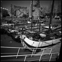 Tjalk (Hans de Meij) Tags: blackandwhite 120 6x6 analog rotterdam ships barges oudehaven bwconversion portra160 kodakportra160 hasselblad503cx distagon450cf epsonv850
